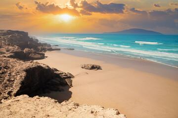 Beautiful sunset illuminating the Agadir beach and sand on the Atlantic ocean coast in Morocco