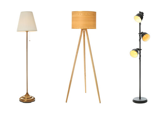 Set with different stylish floor lamps on white background