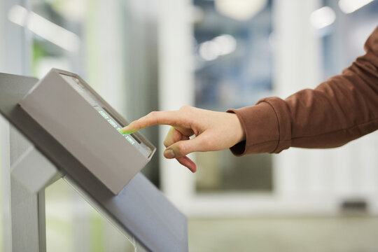 Close-up of woman pushing the buttons and dialing the password to open the door