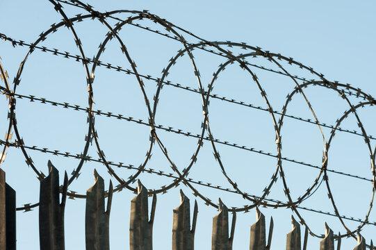 razor-wire fencing around a high security enclosure