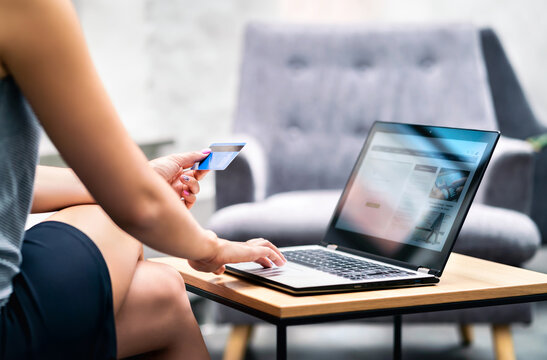 Business woman using credit card payment to purchase. Online bank identification and website in laptop. E commerce transaction data and information for security from fraud. Electronic money transfer.