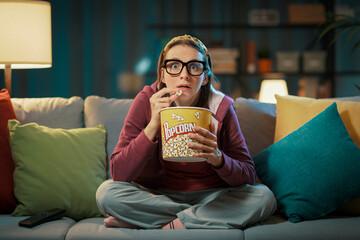 Fototapeta Woman watching a suspense movie obraz