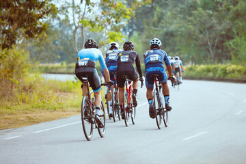 Group of professional cyclists during the cycling race. Shot in back - Image