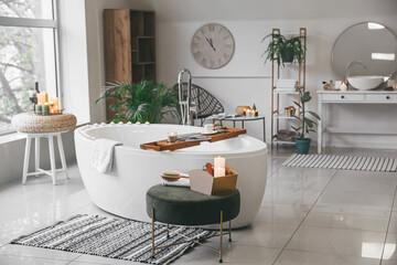 Obraz Stylish interior of modern bathroom with burning candles - fototapety do salonu