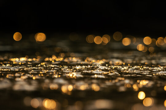 Bokeh From Sunlight That Hits The Water Surface