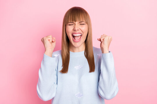 Portrait of attractive crazy cheerful girl rejoicing great luck triumph isolated over pink pastel color background