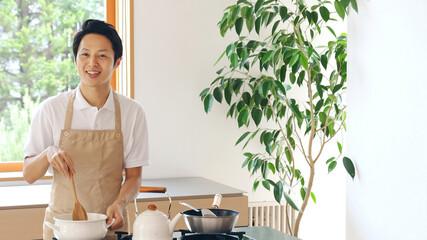 Fototapeta 料理をする男性 obraz