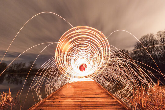 Illuminated Footbridge Against Sky At Night