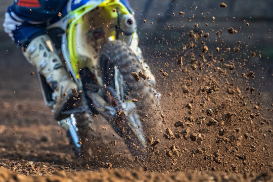 Low Section Of Man Riding Motorcycle In Mud