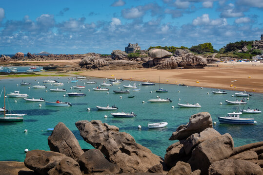 Sailing Boats and transparent water on Coz-Pors beach in Tregastel, Côtes d'Armor, Brittany, France