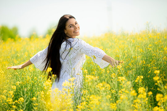 Young woman in the rapeseed field