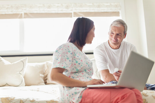 Nurse consulting with senior man at home