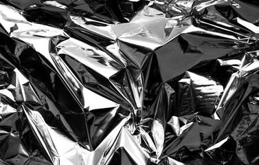 crumpled aluminum foil background. wrinkled shiny silver foil for decoration. creative design...