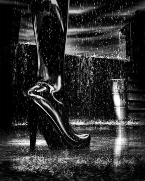 Shinny Boots Of Leather standing in midnight rain in back alley in the city