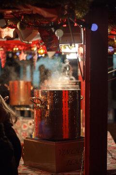 Cauldron Of Hot Wine On Christmas Market In France.