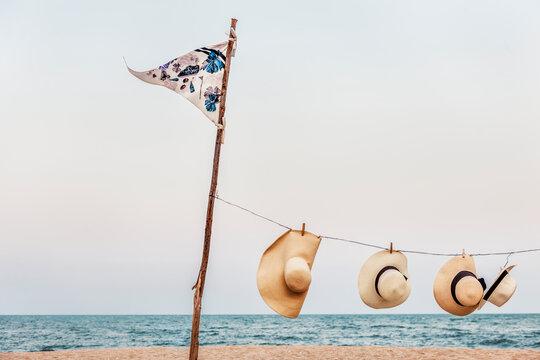 Hanging Peg Woven Hats Flag Pole Sea Shore Concept