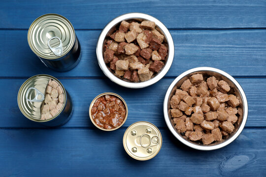 Wet pet food on blue wooden table, flat lay