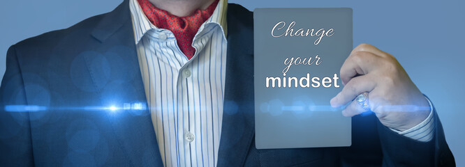 CHANGE YOUR MINDSET message on the card shown by a man in a gray suit