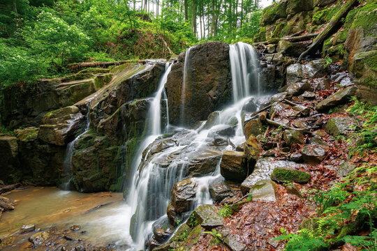 nature scenery with waterfall in spring. powerful water flow in the beech forest