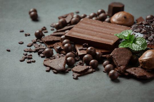 Chocolate on the dark background. World Chocolate Day concept