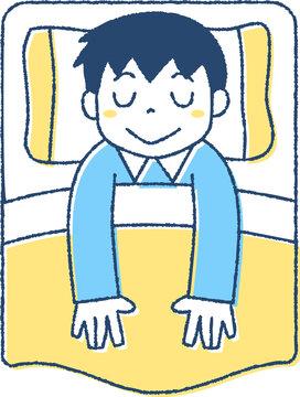 ベッドで眠る男の子