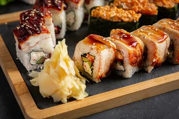 Fototapeta Roll made of Fresh Raw Salmon, Smoked Eel, Cream Cheese and Avocado inside. obraz