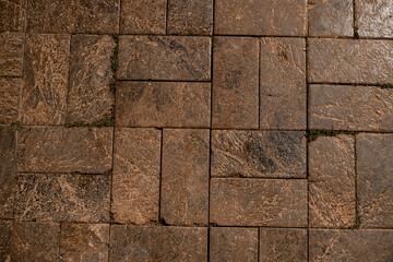 Fototapeta top view of the old square paving slabs masonry obraz