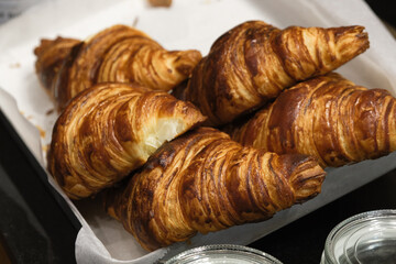 Closeup shot of freshly baked croissants on a tray