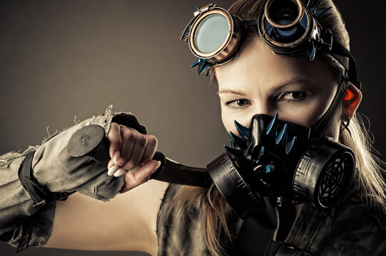 woman in steampunk gas mask with kukri in hand