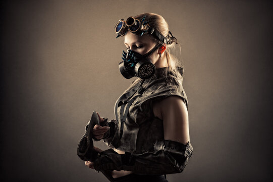 brutal woman in uniform and steampunk mask with axe