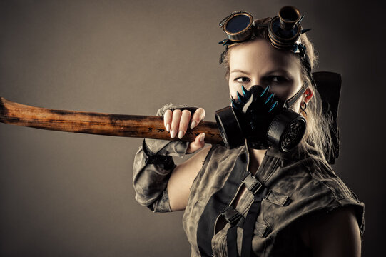 brutal woman in a steampunk mask and ax in hands