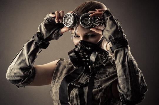 pretty woman in steampunk mask