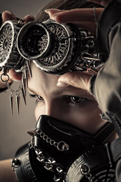 portrait woman in steampunk mask close up
