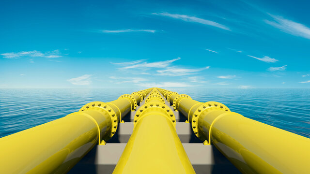 Yellow pipelines on the sea under a blue sky