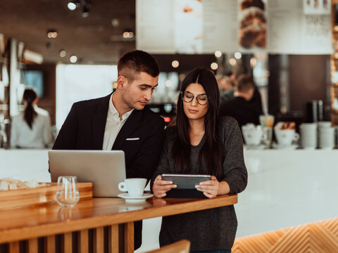 modern man and woman use modern devices, laptop, tablet and smartphone and arrange new projects for the job. Business concept .