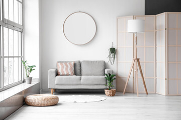 Obraz Interior of modern room with comfortable sofa, mirror and lamp - fototapety do salonu