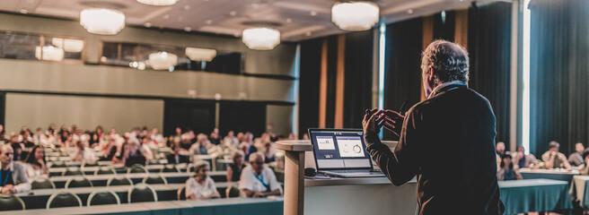 Fototapeta Senior public speaker giving talk at scientific conference. obraz