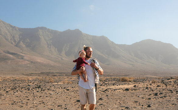 Father bringing his baby on a hike in the mountain