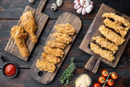 Crispy fried chicken on old dark wooden table, flat lay