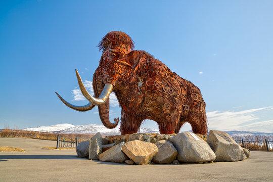 "Sculptural composition ""Time"", Magadan, Magadan Region, Russia - May 12, 2021. Large modern sculpture. A mammoth made from scrap metal. Tourist attraction of Magadan. Landmark of the Russian Far East."