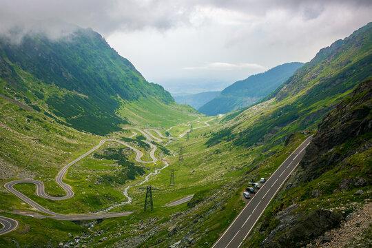 serpentine of transfagarasan road in mountains of romania. gorgeous travel destination in dramatic weathe