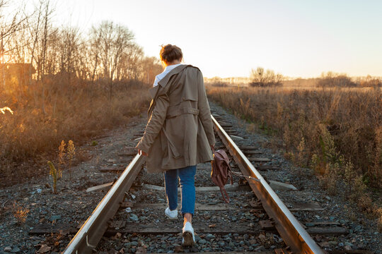 Fashion Lifestyle Portrait Of Young Trendy Woman Dressed In Brown Coat, White Shirt And Jeans Posing