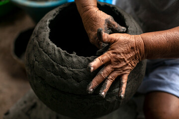 Hands of women craftsmen making clay vessels. These women are cultural living heritage of the fishing community of Manicuare in Venezuela.