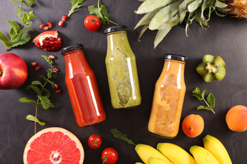 fruit juice in bottle and fresh fruits