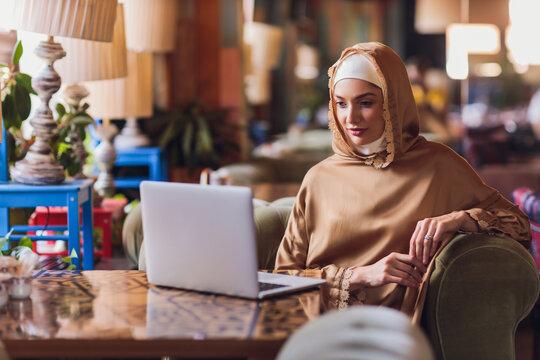 Beautiful Arabic business woman working on computer.