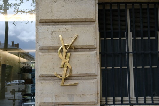 A close up on the facade of an Yves Saint-Laurent store in Paris.