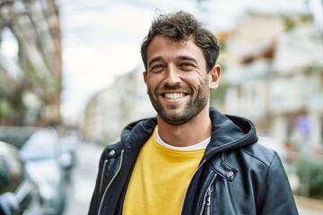 Handsome hispanic man with beard smiling happy outdoors - fototapety na wymiar
