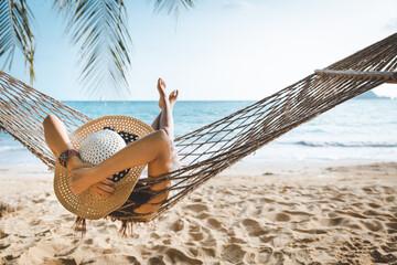 Traveler asian woman relax in hammock on summer beach Thailand