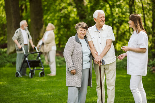 Elder people with the caregiver in the garden