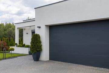 Fototapeta View of the garage door in an elegant suburban home obraz